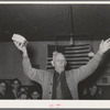 Colonel Lilly auctioning off a piece of cake at pie supper in Muskogee, Oklahoma. See general caption number 24