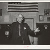 Colonel Lilly, auctioneer at pie supper. McIntosh County, Oklahoma. See general caption number 24