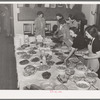 Arranging food on table at buffet supper of the Jaycees at Eufaula, Oklahoma. See general caption number 25