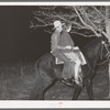 Farm boy and girl riding home after the play party. McIntosh County, Oklahoma. See general caption number 26