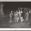 Playing a swing game in the yard. Play party in McIntosh County, Oklahoma. See general caption number 26