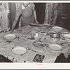 Table being set for supper. House of Pomp Hall, Negro tenant farmer. Creek County, Oklahoma