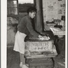 Daughter of Pomp Hall, Negro tenant farmer, cleaning off top of cook stove. Creek County, Oklahoma