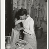 Wife of Pomp Hall, Negro tenant farmer, preparing lunch for her children to take to school. Creek County, Oklahoma