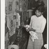 Wife of Pomp Hall, Negro tenant farmer, cleaning lamp chimneys. Creek County, Oklahoma