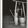 Drawing water from the well in the early morning. Farm of Pomp Hall, Negro tenant farmer. Creek County, Oklahoma