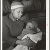 Negro mother and child at local chapter meeting of UCAPAWA (United Cannery, Agricultural, Packing, and Allied Workers of America). Bristow, Oklahoma