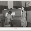 Local singer entertaining at Jaycee buffet supper. Eufaula, Oklahoma. See general caption number 25