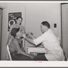 Examination by doctor at the clinic of the Agua Fria migratory labor camp. Arizona