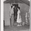 Nurse making a call at one of the individual metal shelters at the Agua Fria migratory labor camp. Arizona