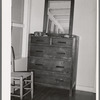 Dresser in bedroom of an apartment at the Arizona part-time farms. Maricopa County, Arizona. The furniture in the apartment on this project was designed especially for them
