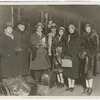 Ballet Russes dancers with Serge Diaghilev standing in front of train with luggage