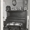 Corner of living room in farm home of tenant purchase client in Maricopa County, Arizona