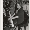 Pianist at community sing. Pie Town, New Mexico. She and her husband were one of the first homesteaders