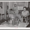 Mrs. Christiansen of the Christiansen canning unit sealing cans. During 1939 she canned 2300 quarts which included 20 mutton, 2 deer, 2 beeves, 5 pigs. Fish was tried very successfully. In this cooperative agreement there were twenty-five users and outside of the cooperative there were ten others who used Mrs. Christiansen's services