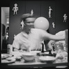 Unidentified image of person at a table on Cakewalk contact sheet.