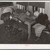 Negro boys during rest period at nursery. There is a shortage of beds. Chicago, Illinois