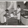 Preparing milk for baby. Family is on relief. Chicago, Illinois