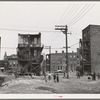 Children playing in vacant lot in Negro section of Chicago, Illinois