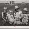 Four smiling children