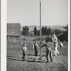 Playtime at the FSA (Farm Security Administration) mobile camp for migratory farm workers. Odell, Oregon
