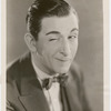 Publicity photograph of Edward Everett Horton winking at the camera