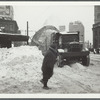 Snow removal on Flatbush Avenue in Brooklyn, near the L.I.R.R. station (at right)