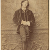 Full-length portrait photograph of Oscar Wilde, matted and framed