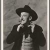 Jimmy Durante [with cigar, straightening cravat] in the stage production Jumbo