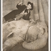 Jimmy Durante lying with elephant Rosie in the stage production Jumbo