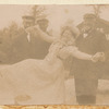 Loie Fuller lifted by two men