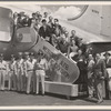 Aline MacMahon, Walter Abel, cast and the crew of the touring company of the stage production Hamlet, posing with military officers in front of Air Force plane at Westover Air Force Base