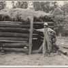Log barn built by rehabilitation client. Cherokee County, Kansas