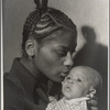 Portrait of a Mother with braided hair holding a young baby