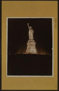 Islands - Bedloe's Island - [View of the Statue of Liberty illuminated at night.]