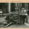 Occupations - Peddlers - Food - [Roast potato vendor and his movable oven on an east side street.]