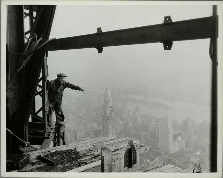 Atop Empire State- in construction; Chrysler Bldg & [Daily] News in middle foreground.