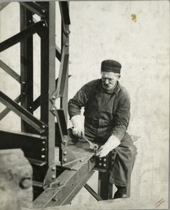 Worker attaching a bolt onto a... Digital ID: 79857. New York Public Library