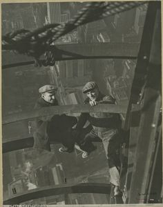 Two workers inspecting steel
