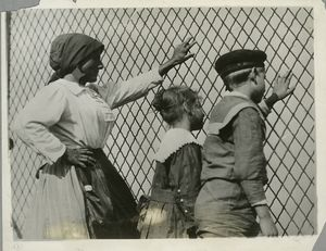 A woman, a boy and a girl at a... Digital ID: 79885. New York Public Library