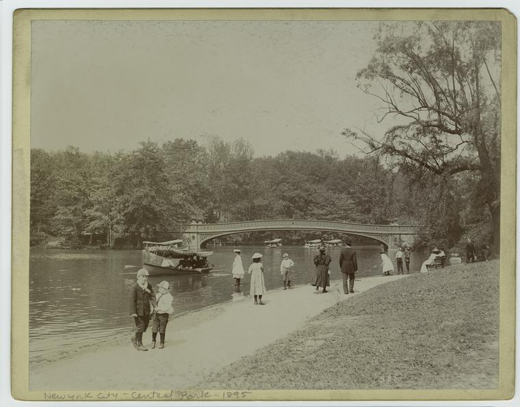 [Adults and children along the lake, Central Park, New York City.]