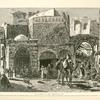The Street of the Damascus Gate with a characteristic group of Bedouins outside a café on the left, a party of Turkish soldiers breakfasting, and on the right a group of dealers in fruit and vegetables