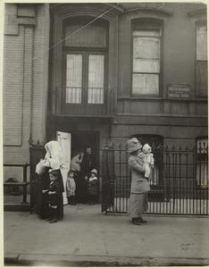 [Mothers and their children leaving West Side Day Nursery and Industrial School, New York City, ca. 1901s.]