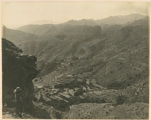 [From Kapirkate overlooking the Khargati Ridge. The battle ground of 11th May 1919. Bagh Springs + village in the distance and remains of old Bhuddist Stapa [?] on extreme left. Ghurkha sentry in foreground.]