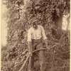 Man grasping a scythe.