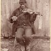 Joe Izzard playing the fiddle