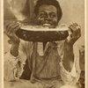 Smiling man eating watermelon, 1920.