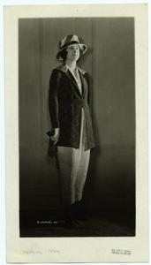 [Woman in diamond-patterned jacket and striped hat, ca. 1920.]