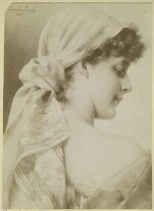 [Woman wearing a scarf over her hair.]