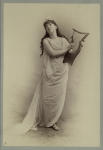 Woman in classical dress holding lyre